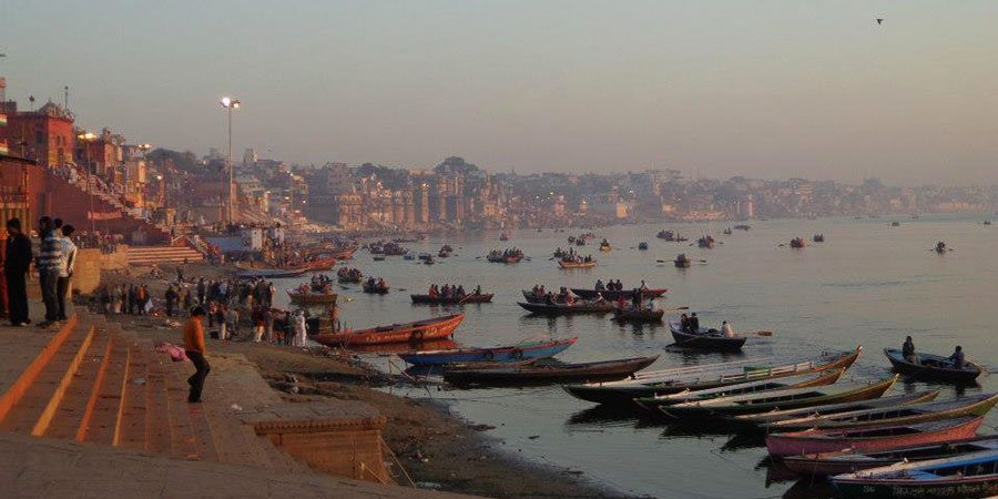 The Ghats and the holy river Ganges at sunrise in Varanasi
