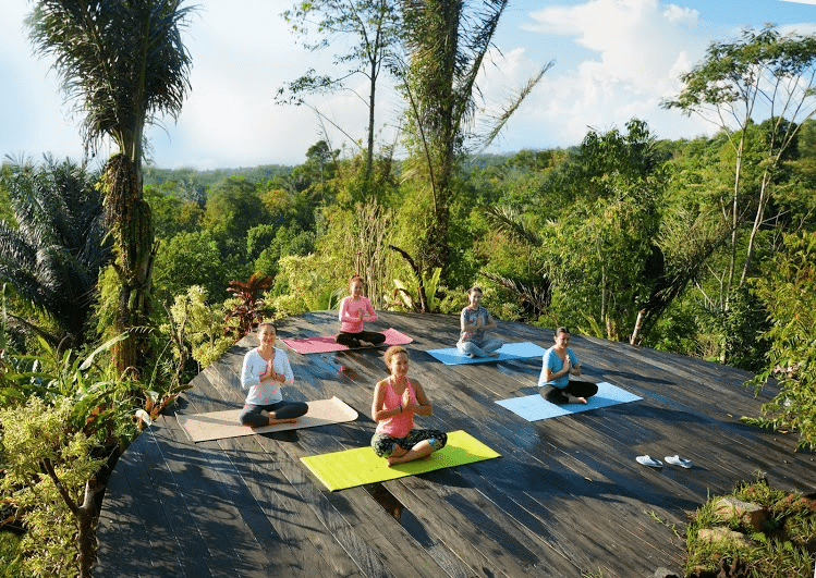 Teaching Yoga in Ubud, Bali. Photo Credit: Nailya Akhundova