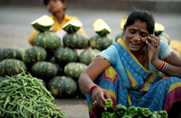 An Indian vegatable seller arranges vega