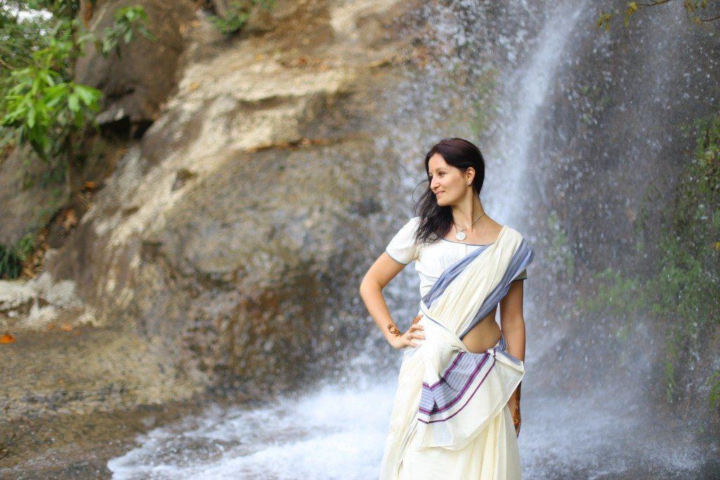 Alex wearing a sari in a waterfal in Wayanad, Kerala