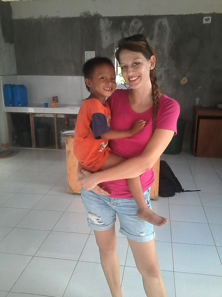 Elsa with one of the kids at her community center in a rural village volunteering in the philippines