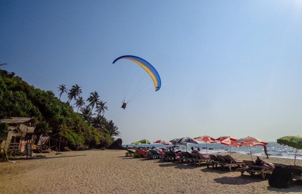 Para gliding over Kalacha Beach just over the rocks from main Arambol Beach