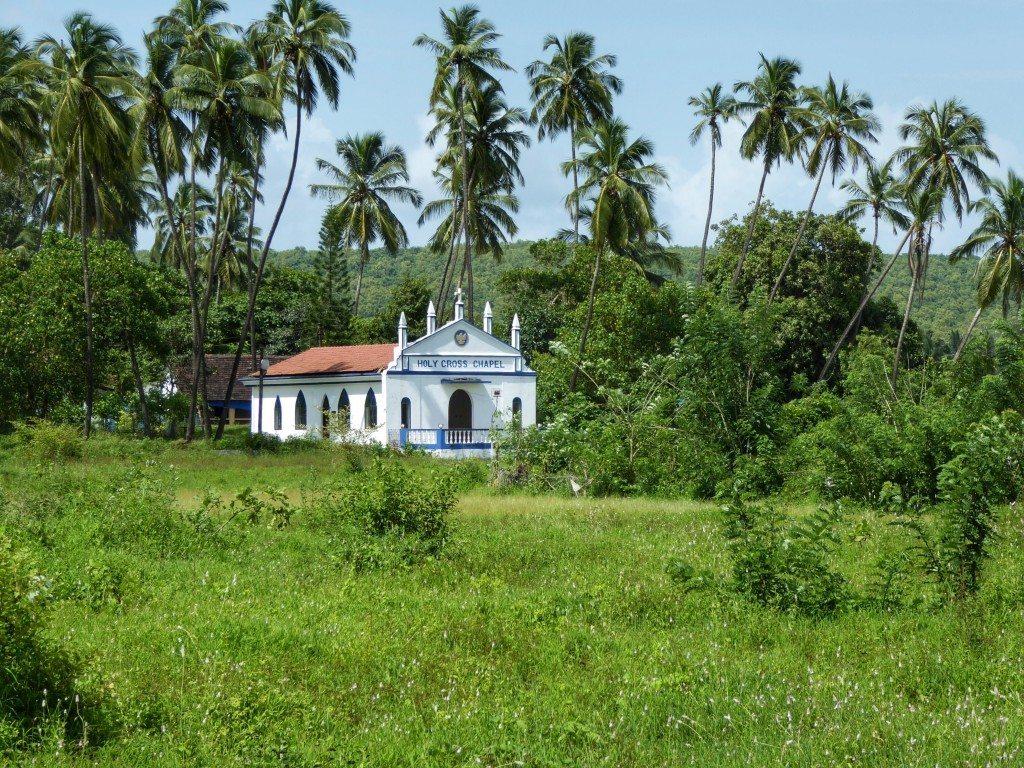 Cute Portuguese churches and green fields in Goa in monsoon season