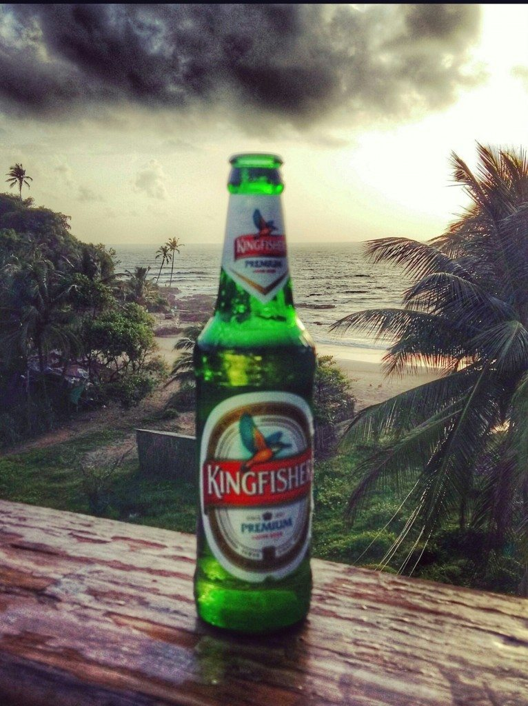Enjoying a Kingfisher beer at sunset overlooking Vagator Beach