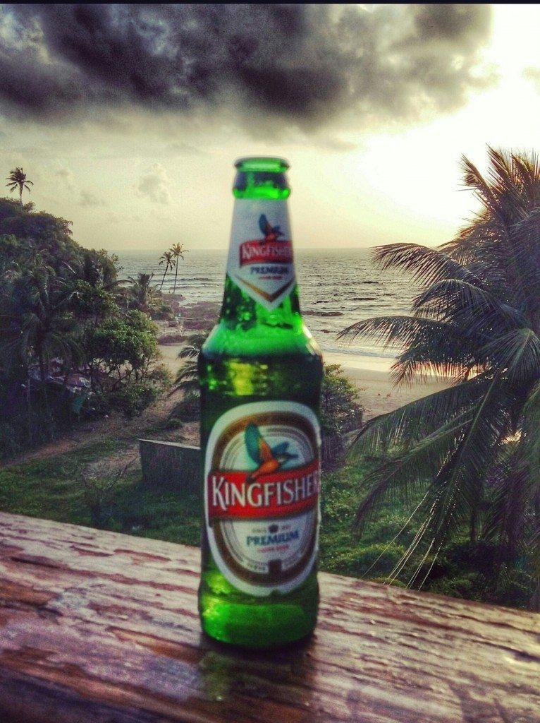 Enjoying a Kingfisher beer at sunset overlooking Vagator Beach