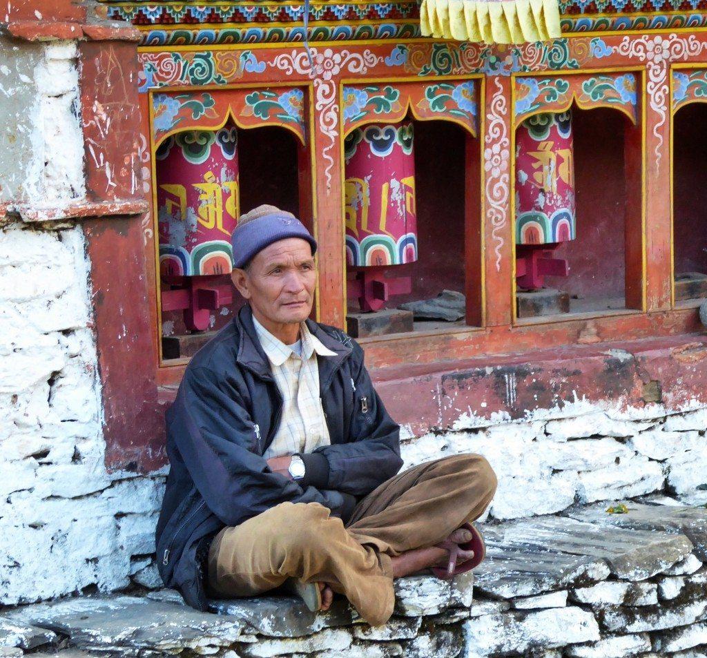 Tibetan man and prayer wheels