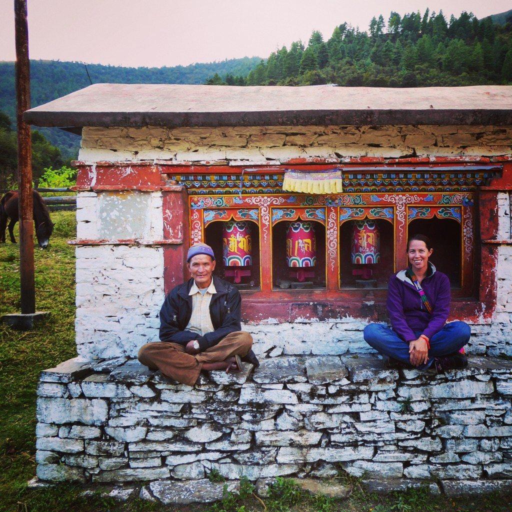 sitting by the tibetan prayer wheels in arunachal pradesh