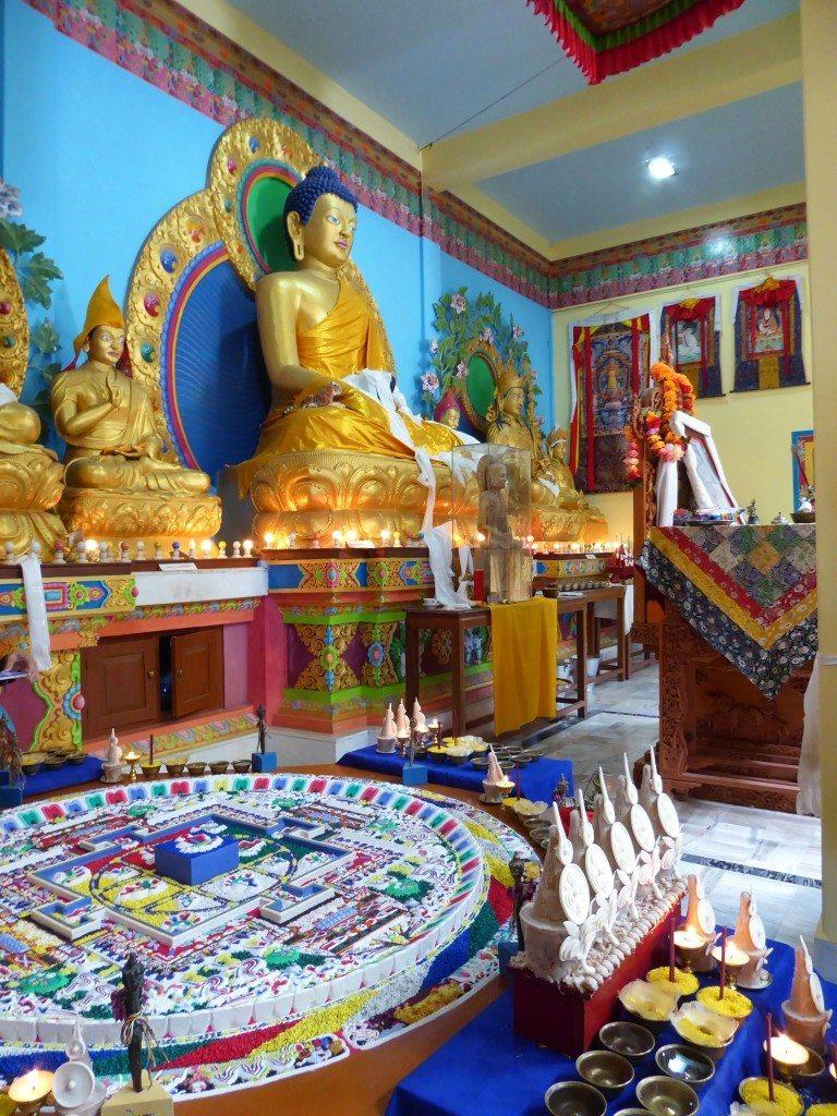 mandala and golden buddha inside Tibetan monastery
