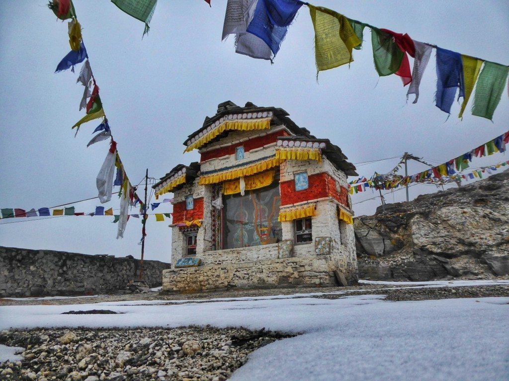 snow and frozen prayer flags on sela pass Arunachal Pradesh