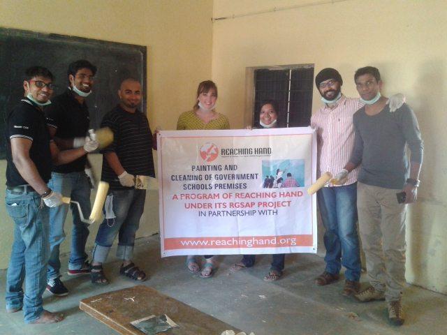 With volunteers, Reaching Hand