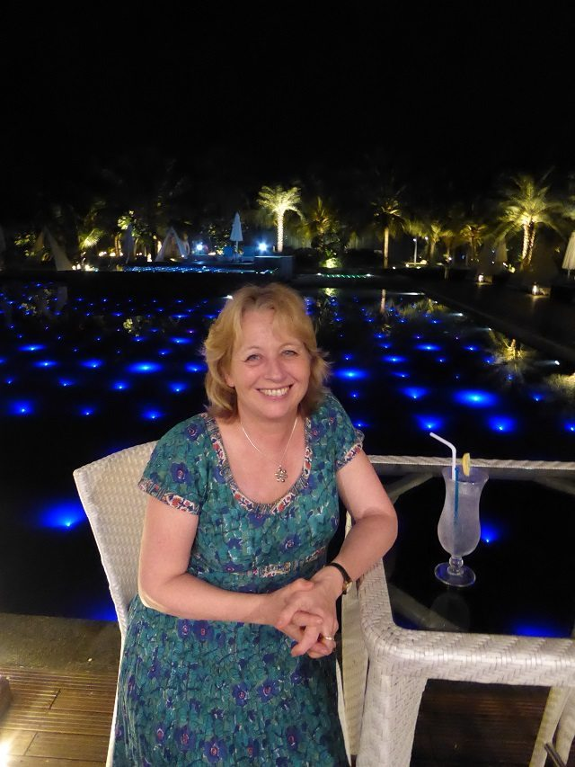 My Mum enjoying cocktails by the pool at Planet Hollywood Resort in South Goa