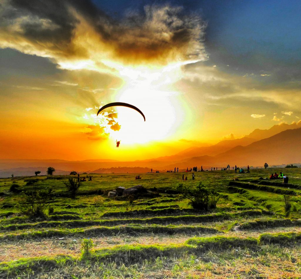 Sunset over the paragliding landing spot in Bir Billing. Himachal Pradesh, India