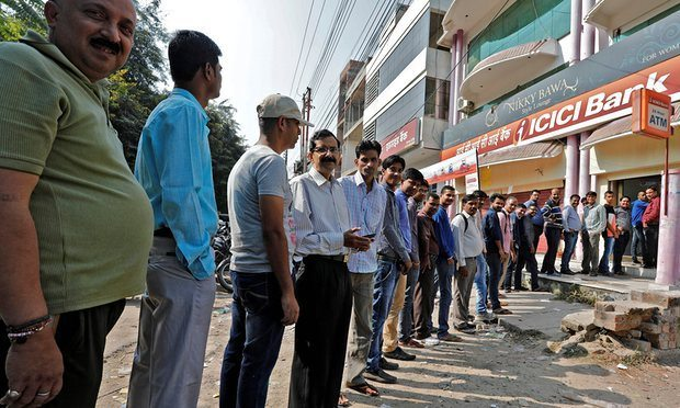 Queuing for money. Photo Credit: The Guardian